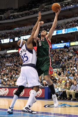 DALLAS - JANUARY 26:  Center Andrew Bogut #6 of the Milwaukee Bucks takes a shot against Erick Dampier #25 of the Dallas Mavericks on January 26, 2010 at American Airlines Center in Dallas, Texas.  NOTE TO USER: User expressly acknowledges and agrees that