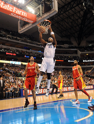 DALLAS - DECEMBER 18:  Center Erick Dampier #25 of the Dallas Mavericks gets the slam dunk against Luis Scola #4 of the Houston Rockets on December 18, 2009 at American Airlines Center in Dallas, Texas.  NOTE TO USER: User expressly acknowledges and agree