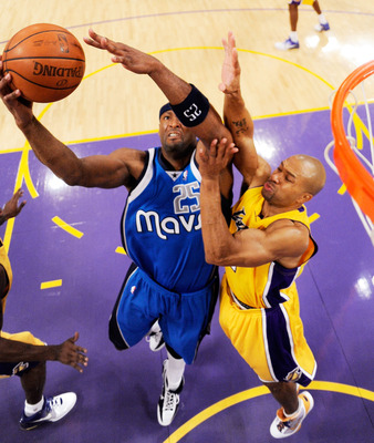 LOS ANGELES, CA - OCTOBER 30: Erick Dampier #25 (L)  of the Dallas Mavericks fight for a rebound against Derek Fisher #2 of the Los Angekes Lakers during the basketball game at Staples Center on October 30, 2009 in Los Angeles, California. NOTE TO USER: U