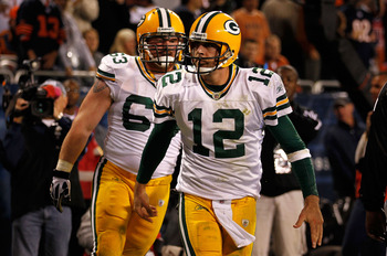 CHICAGO - SEPTEMBER 27:  Aaron Rodgers (R) #12 and Scott Wells #63 of the Green Bay Packers react after Rodgers scored a 3-yard rushing touchdown in the fourth quarter against the Chicago Bears at Soldier Field on September 27, 2010 in Chicago, Illinois.