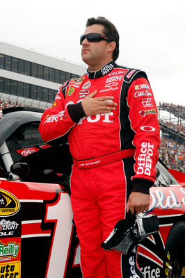 DOVER, DE - SEPTEMBER 26:  Tony Stewart, driver of the #14 Office Depot/Old Spice Chevrolet,  stands on the grid prior to the NASCAR Sprint Cup Series AAA 400 at Dover International Speedway on September 26, 2010 in Dover, Delaware.  (Photo by Justin Heim
