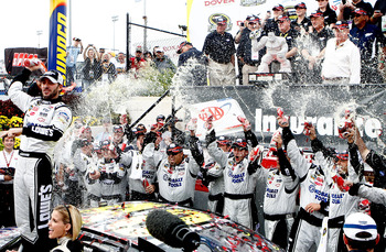 DOVER, DE - SEPTEMBER 26:  Jimmie Johnson, driver of the #48 Lowe's Chevrolet, celebrates in Victory Lane after winning the NASCAR Sprint Cup Series AAA 400 at Dover International Speedway on September 26, 2010 in Dover, Delaware.  (Photo by Jeff Zelevans