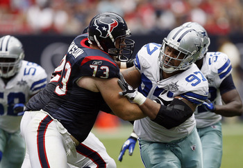 HOUSTON - SEPTEMBER 26:  Tackle Eric Winston #73 of the Houston Texans locks up with defensive end Jason Hatcher #97 of the Dallas Cowboys during the fourth quarter at Reliant Stadium on September 26, 2010 in Houston, Texas.  (Photo by Bob Levey/Getty Ima