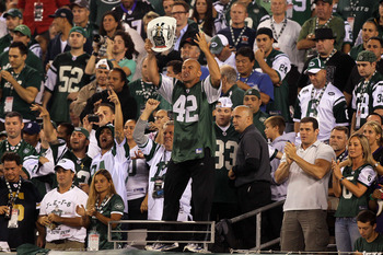EAST RUTHERFORD, NJ - SEPTEMBER 13:  New York Jets fan fireman Ed Anzalone cheers for the New York Jets during their home opener against the Baltimore Ravens at the New Meadowlands Stadium on September 13, 2010 in East Rutherford, New Jersey.  (Photo by J