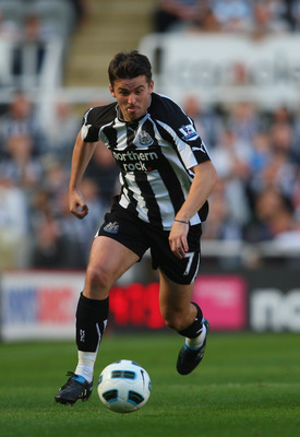 NEWCASTLE UPON TYNE, ENGLAND - SEPTEMBER 11: Newcastle player Joey Barton in action during the Barclays Premier League match between Newcastle United and Blackpool at St James' Park on September 11, 2010 in Newcastle upon Tyne, England.  (Photo by Stu For