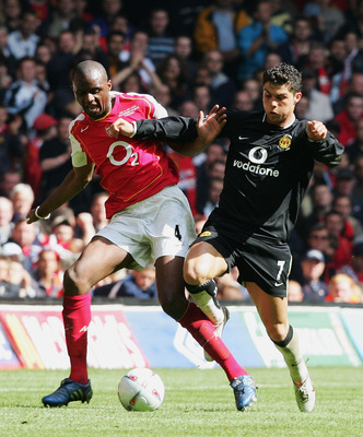 CARDIFF, UNITED KINGDOM - MAY 21:  Patrick Vieira of Arsenal and Ronaldo of Manchester United battle for the ball during the FA Cup Final between Arsenal and Manchester United at The Millennium Stadium on May 21, 2005 in Cardiff, Wales.  (Photo by Ross Ki