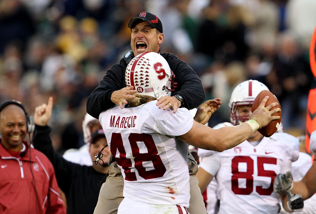 SOUTH BEND, IN - SEPTEMBER 25: Head coach Jim Harbaugh of the Stanford Cardinal jumps to greet Owen Marecic #48 after Marecic intercepted a pass for a touchdown against the Notre Dame Fighting Irish at Notre Dame Stadium on September 25, 2010 in South Ben