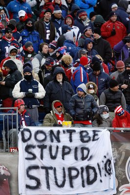 FOXBORO, MA - JANUARY 10:  Fans of the New England Patriots hang a sign which reads 'Don't Be Stupid, Stupid!' against the Baltimore Ravens during the 2010 AFC wild-card playoff game at Gillette Stadium on January 10, 2010 in Foxboro, Massachusetts.  (Pho