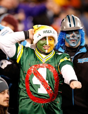 CHARLOTTE, NC - DECEMBER 20:  A Green Bay Packers fan wears an old jersey of quarterback Brett Favre (not pictured) #4 of the Minnesota Vikings during the game against the Carolina Panthers at Bank of America Stadium on December 20, 2009 in Charlotte, Nor