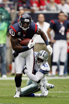 HOUSTON - SEPTEMBER 26:  Wide receiver Andre Johnson #80 of the Houston Texans attempts to shake the tackle of cornerback Terence Newman #41 of the Dallas Cowboys at Reliant Stadium on September 26, 2010 in Houston, Texas.  (Photo by Bob Levey/Getty Image