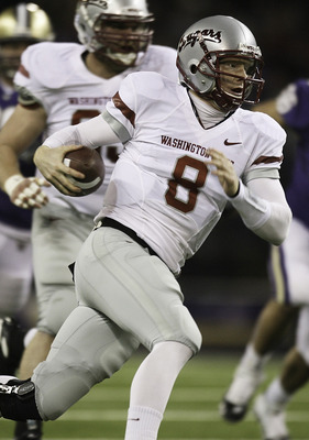 SEATTLE - NOVEMBER 28:  Quarterback Marshall Lobbestael #8 of the Washington State Cougars rushes against the Washington Huskies on November 28, 2009 at Husky Stadium in Seattle, Washington. (Photo by Otto Greule Jr/Getty Images)