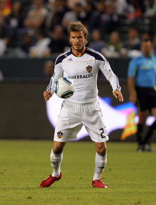 CARSON, CA - SEPTEMBER 18:  David Beckham #23 of the Los Angeles Galaxy plays the ball off his chest during their MLS match against D.C. United at The Home Depot Center on September 18, 2010 in Carson, California. The Galaxy defeated United 2-1.  (Photo b