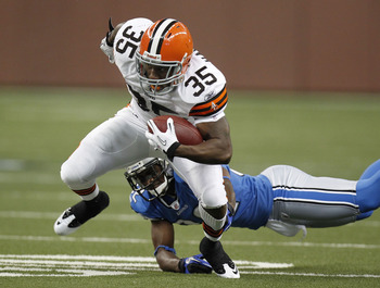 DETROIT - AUGUST 28: Jerome Harrison #35 of the Cleveland Browns tries to escape the tackle of Dre Bly #32 of the Detroit Lions during preseason game on August 28, 2010 at Ford Field in Detroit, Michigan.  (Photo by Gregory Shamus/Getty Images)