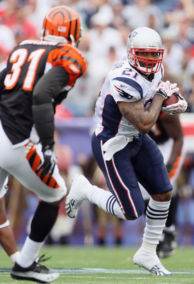FOXBORO, MA - SEPTEMBER 12:  Fred Taylor #21 of the New England Patriots carries the ball as Roy Williams #31 defends during the NFL season opener on September 12, 2010 at Gillette Stadium in Foxboro, Massachusetts. The Patriots defeated the Bengals 38-24