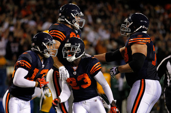 CHICAGO - SEPTEMBER 27:  (L-R) Johnny Knox, Greg Olsen #82, Devin Hester #23 and Kevin Shaffer #78 of the Chicago Bears celebrate after Olsen scored a  9-yard touchdown in the second quarter against the Green Bay Packers at Soldier Field on September 27,