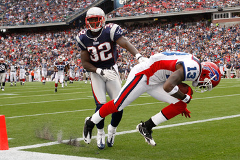 FOXBORO, MA - SEPTEMBER 26:  Steve Johnson #13 of  the Buffalo Bills scores a touchdown against the defense of Devin McCourty #32 of the New England Patriots in the second half at Gillette Stadium on September 26, 2010 in Foxboro, Massachusetts. (Photo by