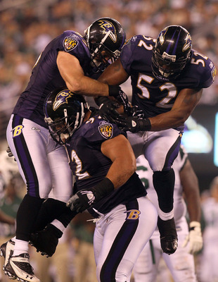 EAST RUTHERFORD, NJ - SEPTEMBER 13:  Ray Lewis #52 and Jarret Johnson #95 jump on Haloti Ngata #92 of the Baltimore Ravens after a sack in the fourth quarter against the New York Jets during their home opener at the New Meadowlands Stadium on September 13