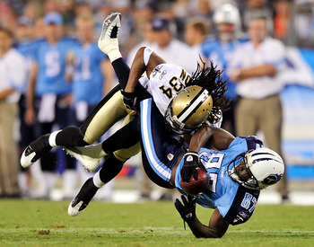 NASHVILLE, TN - SEPTEMBER 02:  Patrick Robinson #34 of the New Orleans Saints makes the hit on Lavelle Hawkins #87 of the Tennessee Titans after a 5-yard gain during the first half of an exhibition game at LP Field on September 2, 2010 in Nashville, Tenne