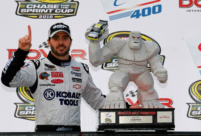 DOVER, DE - SEPTEMBER 26: Jimmie Johnson, driver of the #48 Lowe's/Kobalt Tools Chevrolet, celebrates in Victory Lane after winning the NASCAR Sprint Cup Series AAA 400 at Dover International Speedway on September 26, 2010 in Dover, Delaware.  (Photo by G