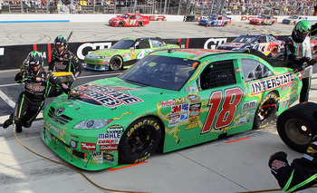 DOVER, DE - SEPTEMBER 26:  Kyle Busch, driver of the #18 Interstate Batteries Toyota, pits during the NASCAR Sprint Cup Series AAA 400 at Dover International Speedway on September 26, 2010 in Dover, Delaware.  (Photo by Jim McIsaac/Getty Images for NASCAR
