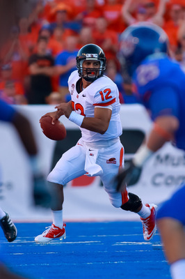 BOISE, ID - SEPTEMBER 25:  Quarterback Ryan Katz #12 of the Oregon State Beavers looks for a receiver against the Boise State Broncos at Bronco Stadium on September 25, 2010 in Boise, Idaho.  (Photo by Otto Kitsinger III/Getty Images)
