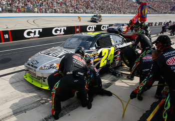 DOVER, DE - SEPTEMBER 26: Jeff Gordon, driver of the #24 DuPont/Law Enforcement Museum Chevrolet, pits during the NASCAR Sprint Cup Series AAA 400 at Dover International Speedway on September 26, 2010 in Dover, Delaware.  (Photo by Geoff Burke/Getty Image