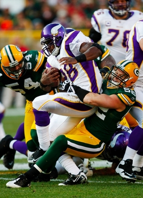 GREEN BAY, WI - NOVEMBER 01:  Clay Matthews #52 of the Green Bay Packers tackles Adrian Peterson #28 of the Minnesota Vikings during the first quarter of the game at Lambeau Field on November 1, 2009 in Green Bay, Wisconsin. (Photo by Scott Boehm/Getty Im