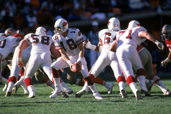SAN FRANCISCO - NOVEMBER 9:  Quarterback Cliff Stoudt #18 of the St. Louis Cardinals runs a play during a game against the San Francisco 49ers at Candlestick Park on November 9, 1986 in San Francisco, California.  The 49ers won 43-17.  (Photo by George Ro