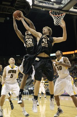 KANSAS CITY, MO - NOVEMBER 24: Gabe Blair #32 and Garrett Stutz #41 of the Wichita State Shockers rebounds the ball against Matt Gatens #5 and  Jarryd Cole #50 of the Iowa Hawkeyes during the CBE Classic consolation game on November 24, 2009 at Sprint Cen
