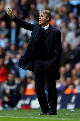 MANCHESTER, ENGLAND - SEPTEMBER 25:  Manchester City Manager Roberto Mancini issues instructions during the Barclays Premier League match between Manchester City and Chelsea at the City of Manchester Stadium on September 25, 2010 in Manchester, England.