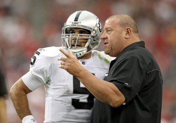 GLENDALE, AZ - SEPTEMBER 26:  Head coach Tom Cable of the Oakland Raiders talks with quarterback Bruce Gradkowski #5 during the fourth quarter of the NFL game against the Arizona Cardinals at the University of Phoenix Stadium on September 26, 2010 in Glen