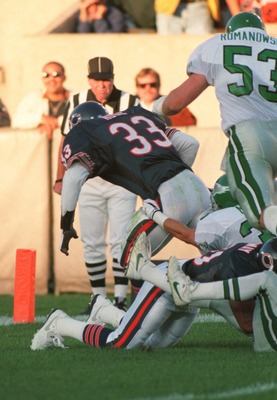 5 AUG 1994:  MERRIL HOGE OF THE CHICAGO BEARS DRIVES OVER FOR A TOUCHDOWN DURING THE BEARS'' 12-6 PRESEASON WIN OVER THE PHILADELPHIA EAGLES AT SOLDIER FIELD IN CHICAGO, ILLINOIS. Mandatory Credit: Jonathan Daniel/ALLSPORT