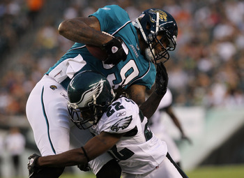 PHILADELPHIA - AUGUST 13: Marcedes Lewis #89 of the Jacksonville Jaguars is tackled by Asante Samuel #22 of the Philadelphia Eagles during their preseason game at Lincoln Financial Field on August 13, 2010 in Philadelphia, Pennsylvania.  (Photo by Nick La