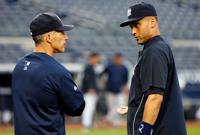 NEW YORK - SEPTEMBER 26:  Manager Joe Girardi #28 and Derek Jeter #2 of the New York Yankees talk during warm-ups prior to their game against the Boston Red Sox on September 26, 2010 at Yankee Stadium in the Bronx borough of New York City.  (Photo by Mike