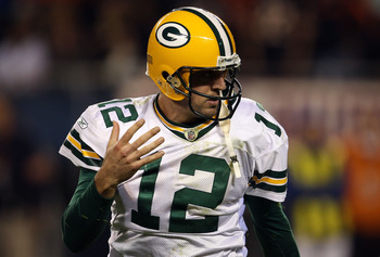 CHICAGO - SEPTEMBER 27:  Quarterback Aaron Rodgers #12 of the Green Bay Packers reacts against the Chicago Bears at Soldier Field on September 27, 2010 in Chicago, Illinois.  (Photo by Jonathan Daniel/Getty Images)
