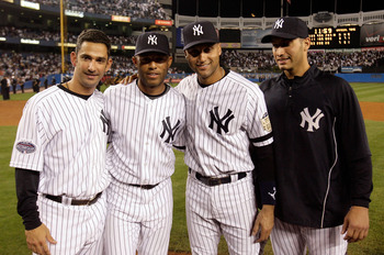 NEW YORK - SEPTEMBER 21:  (L-R) Jorge Posada #20, Mariano Rivera #42, Derek Jeter #2 and Andy Pettitte #46 pose for a photograph after defeating the Baltimore Orioles of the New York Yankees during the last regular season game at Yankee Stadium on Septemb