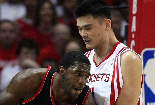 HOUSTON - APRIL 26:  Center Greg Oden #52 of the Portland Trail Blazers dribbles the ball against Yao Ming #11 of the Houston Rockets in Game Four of the Western Conference Quarterfinals during the 2009 NBA Playoffs at Toyota Center on April 26, 2009 in H