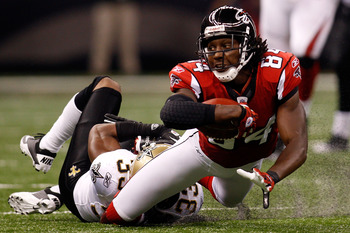 NEW ORLEANS - SEPTEMBER 26:  Roddy White #84 of the Atlanta Falcons is tackled by Jabari Greer #33 of the New Orleans Saints at the Louisiana Superdome on September 26, 2010 in New Orleans, Louisiana.  The Falcons defeated the Saints 27-24.  (Photo by Chr