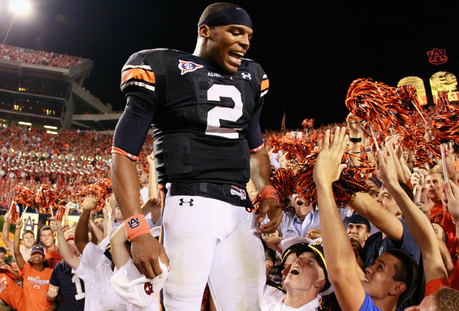 AUBURN, AL - SEPTEMBER 25:  Quarterback Cameron Newton #2 of the Auburn Tigers celebrates in the stands after their 35-27 win over the South Carolina Gamecocks at Jordan-Hare Stadium on September 25, 2010 in Auburn, Alabama.  (Photo by Kevin C. Cox/Getty