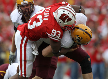 MADISON, WI - SEPTEMBER 18: Louis Nzegwu #93 of the Wisconsin Badgers sacks Steven Threet #14 of the Arizona State Sun Devils at Camp Randall Stadium on September 18, 2010 in Madison, Wisconsin.  Wisconsin defeated Arizona State 20-19. (Photo by Jonathan