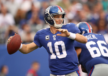 EAST RUTHERFORD, NJ - SEPTEMBER 26:  Eli Manning #10 of the New York Giants passes during a game against the Tennessee Titans at New Meadowlands Stadium on September 26, 2010 in East Rutherford, New Jersey.  (Photo by Mike Ehrmann/Getty Images)