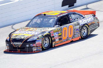 HAMPTON, GA - SEPTEMBER 04:  David Reutimann drives the #00 Aaron's Outdoors Toyota during practice for the NASCAR Sprint Cup Series Emory Healthcare 500 at Atlanta Motor Speedway on September 4, 2010 in Hampton, Georgia.  (Photo by John Harrelson/Getty I