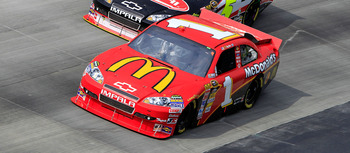 DOVER, DE - SEPTEMBER 26:  Jamie McMurray, driver of the #1 McDonalds's Chevrolet, races Mark Martin, driver of the #5 Delphi/GoDaddy.com Chevrolet, during the NASCAR Sprint Cup Series AAA 400 at Dover International Speedway on September 26, 2010 in Dover