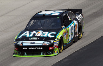 DOVER, DE - SEPTEMBER 24:  Carl Edwards drives the #99 Aflac Ford during practice for the NASCAR Sprint Cup Series AAA 400 at Dover International Speedway on September 24, 2010 in Dover, Delaware.  (Photo by Nick Laham/Getty Images)