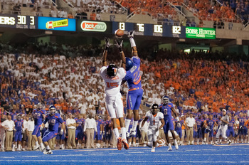 BOISE, ID - SEPTEMBER 25:  Wide receiver Darrell Catchings #15 of the Oregon State Beavers goes up for a catch over safety Jeron Johnson #23 of the Boise State Broncos at Bronco Stadium on September 25, 2010 in Boise, Idaho.  (Photo by Otto Kitsinger III/