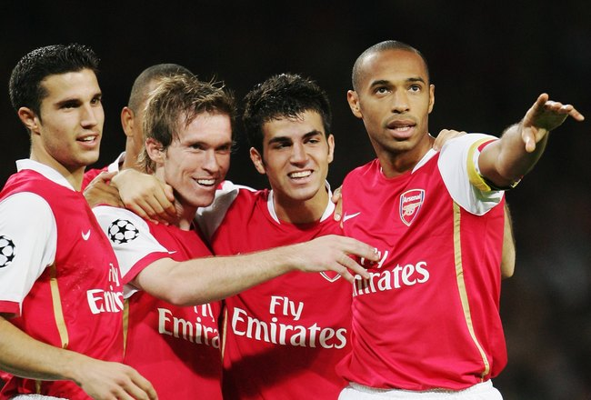 LONDON - SEPTEMBER 26:  Alexander Hleb (2nd left) of Arsenal celebrates scoring the second goal with team mates Robin Van Persie (1st left), Francesc Fabregas (2nd right) and Thierry Henry (right)  during the UEFA Champions League Group G match between Ar