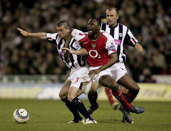 WEST BROMWICH, ENGLAND - MAY 2: Patrick Vieira of Arsenal tangles with Neil Clement of West Brom during the Barclays Premiership game between West Bromwich Albion and Arsenal at The Hawthorns on May 2, 2005 in Birmingham, England.  (Photo by Stu Forster/G