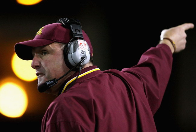 TEMPE, AZ - DECEMBER 31:  Head coach Tim Brewster of the Minnesota Golden Gophers signals for a first down during the Insight Bowl against the Iowa State Cyclones at Arizona Stadium on December 31, 2009 in Tempe, Arizona. The Cyclones defeated the Golden