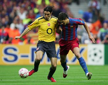 PARIS - MAY 17:  (L-R) Robert Pires of Arsenal holds off the challenge of Edmilson of Barcelona during the UEFA Champions League Final between Arsenal and Barcelona at the Stade de France on May 17, 2006 in Paris, France.  (Photo by Alex Livesey/Getty Ima