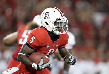 TUCSON, AZ - SEPTEMBER 25:  Runningback Nic Grigsby #5 of the Arizona Wildcats runs with the football during the college football game against the California Golden Bears at Arizona Stadium on September 25, 2010 in Tucson, Arizona.   The Wildcats defeated